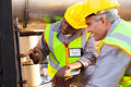 Mechanical engineers working two on fuel pipeline in plant Royalty Free Stock Image