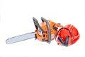 Mechanical gasoline powered chainsaw with protective gear and accesories isolated on white Royalty Free Stock Photo