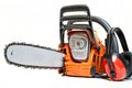 Mechanical gasoline powered chainsaw with protective gear and accesories isolated on white background Royalty Free Stock Images