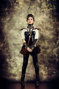 Mechanical lady portrait of a beautiful steampunk woman over grunge background Royalty Free Stock Photography