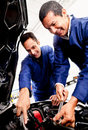Mechanics fixing a car Stock Photography