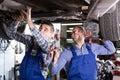 Mechanics fixing car Royalty Free Stock Photo