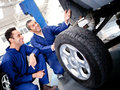 Mechanics fixing a puncture Royalty Free Stock Photos