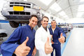 Mechanics with thumbs up Royalty Free Stock Photo