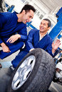 Mechanics working on car puncture Royalty Free Stock Photo