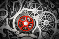 Mechanism, clockwork with one different, red cogwheel. Royalty Free Stock Photo