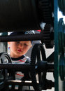 Mechanism little boy observing wheels on old lighthouse Stock Photos