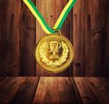 Medal golden on the wood background Royalty Free Stock Photos