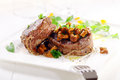 Medallions of fillet steak with wild mushrooms gourmet dinner thick juicy tied string topped and served garnished Royalty Free Stock Photos