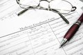 Medi form medicare insurance with glasses and pen Royalty Free Stock Images