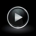 Media play arrow icon inside round silver and black emblem