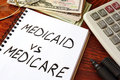 Medicaid vs Medicare written in a note. Royalty Free Stock Photo