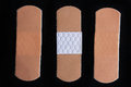 Medical adhesive bandage on black background Stock Images