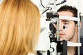 Medical attendance at the optometrist Stock Photos