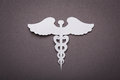 Medical background, Paper cut of Caduceus medical symbol Royalty Free Stock Photo