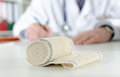 Medical bandage on the desk of a doctor Stock Photo
