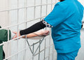 Medical care at prison female nurse measures prisoners blood pressure Stock Photo