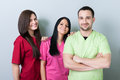 Medical or dental team standing and smiling with confidence Stock Photos