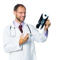 Medical doctor checking x ray portrait of senior holding white background Stock Photo