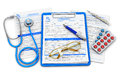 Medical doctor insurance and healthcare concept clipboard with prescription medicine drug claim form stethoscope eyeglasses and Stock Photo