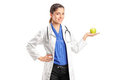 Medical doctor with stethoscope holding an apple Royalty Free Stock Photography