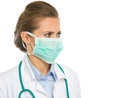 Medical doctor woman mask looking copy space isolated white Royalty Free Stock Photo