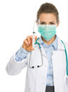 Medical doctor woman mask showing syringe isolated white Stock Photo