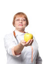 Medical doctor woman smile with stethoscope hold dreen fresh apple in hand isolated over white background Stock Image