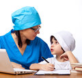 Medical family mom doctor tells her son about medicine Royalty Free Stock Photo