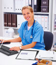 Medical - friendly doctor smiling in office Stock Photography