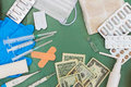 Medical items and money on table. Royalty Free Stock Photo