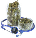 Medical jar with marijuana and doctors stethoscope Royalty Free Stock Photography