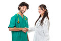 Medical job a beautiful young doctor and an hand some nurse with sthetoscopes over white background Stock Photo