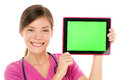 Medical nurse doctor showing tablet pc computer screen green with copy space for your text or design mixed race asian chinese Stock Photography