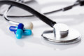 Medical pills and stethoscope. Royalty Free Stock Photo