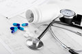 Medical pills and stethoscope Royalty Free Stock Photo