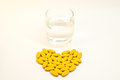 Medical pills tablets capsules caplets glass heart Royalty Free Stock Image