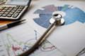 Medical practice financial analysis charts with stethoscope and