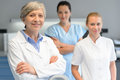 Medical professional team woman at dental surgery Royalty Free Stock Photo