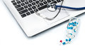 Medical Research, stethoscope  on laptop keyboard with Capsule Royalty Free Stock Photo