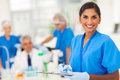 Medical researcher report cheerful young indian writing in the lab Royalty Free Stock Photo
