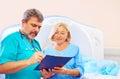 Medical staff filling application form for ct scanner procedure senior Royalty Free Stock Image