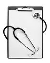 Medical stethoscope on clipboard Royalty Free Stock Image