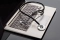 Medical stethoscope over laptop