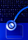 Medical stethoscope and technology concept a portable laptop information Stock Image