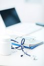 Medical stuff vertical image of being arranged on desk Royalty Free Stock Photos