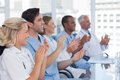 Medical team clapping their hands during a meeting Stock Image