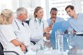 Medical team examining a file in bright office Royalty Free Stock Photo