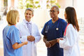 Medical team having discussion outdoors standing in a circle listening Stock Images