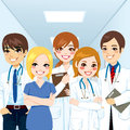 Medical team professionals group of standing in a hospital corridor smiling with arms crossed Royalty Free Stock Images